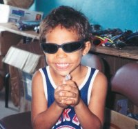 A Boy in Belize Is Excited To Receive Sunglasses